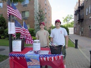 """Dan LaRose and Chris H. sell """"Support Our Troops"""" wristbands at Belmont Fair in support of Eagle project to build a shed and picnic table for United Veteran's  Beacon House in Islip."""