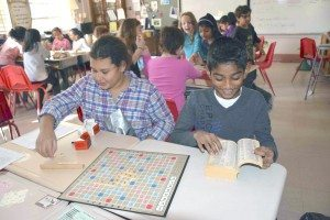 Students play Scrabble.