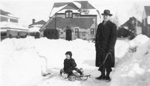 After the blizzard of 1948, Jack Garland enjoys the Flexible Flyer on Berkley Road with his dad.