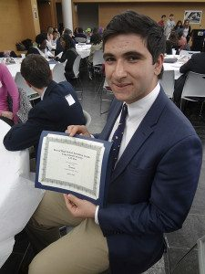 Right: Peter Charalambous, online editor-in-chief for Chaminade High School, with his paper's third place award for Best Online Publication.