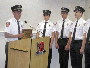 Istri at the podium with other junior firefighters
