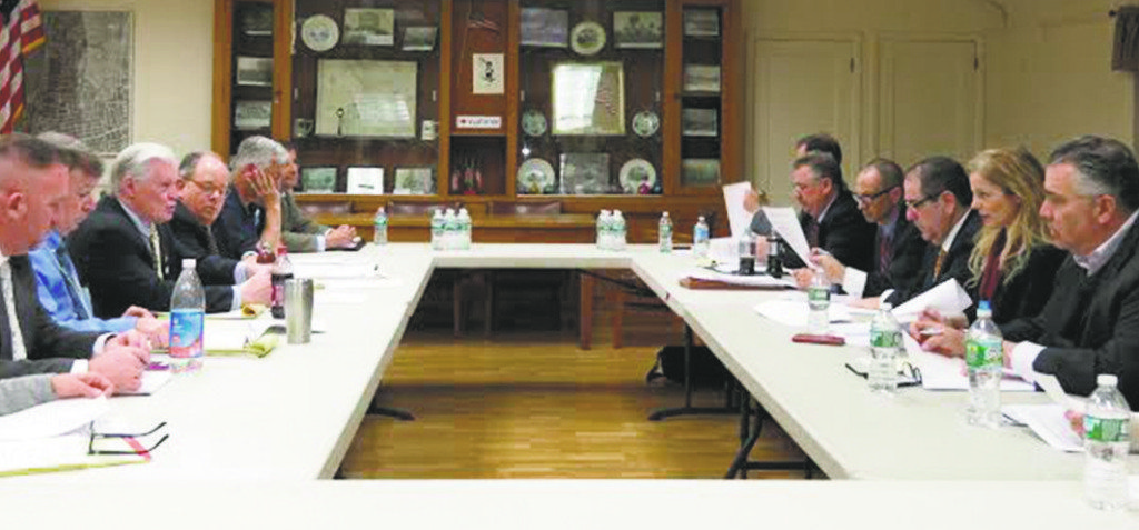 The Williston Park (left) and East Williston board of trustees finalized a water agreement last week.