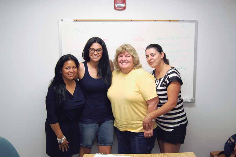 Nassau Literacy volunteer teacher Kathy Novak (second from right) with her students Gladys, Giada and Alcina.