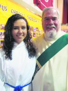 Corpus Christi grads Kirsten Cunha and Deacon Brian Mannix